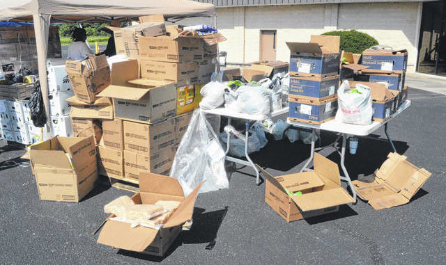 Boxes and bags at the Three in One food distribution event full of food ready to be given to those in need.                                  Michael B. Hardison | Sampson Independent