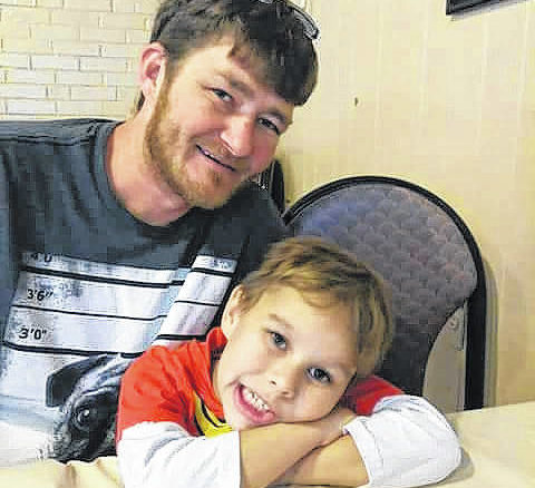 Brian Graham with son Titus. Brian was struck and killed by a hit-and-run driver in Sampson County in early 2018 and authorities are still searching for the person responsible.