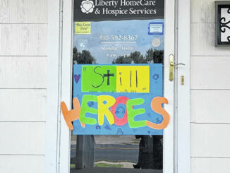 The Be Still, Heroes banner that can be seen proundly displayed at Liberty HomeCare.