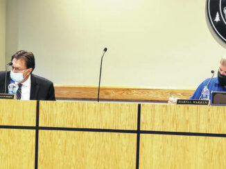 Sampson County Schools Superintendent Dr. David Goodin, left, explained the need for the masking policy, as Chairman Darryl Warren listened.