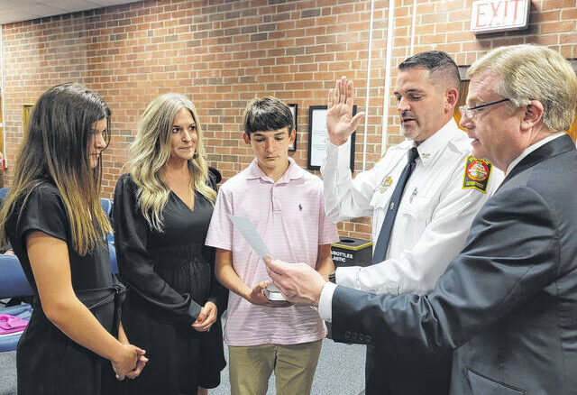 Surrounded by his family, Anthony Davis was sworn in this week as the new Chief of Police in Clinton.