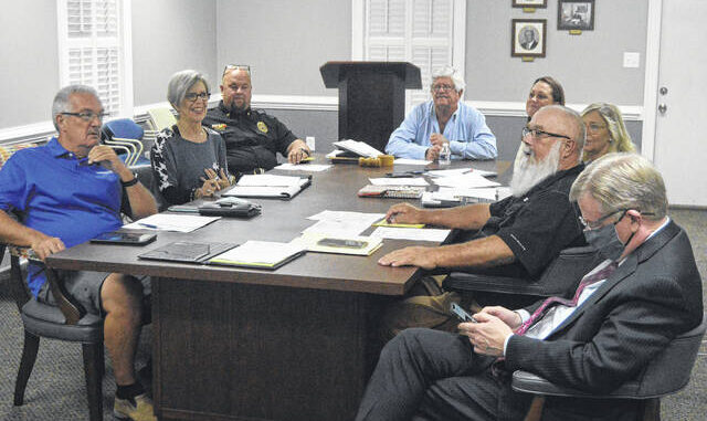 The Newton Grove town board shares conversation before the start of Monday night's meeting.                                  Michael B. Hardison   Sampson Independent